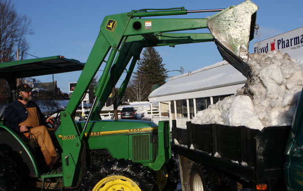 Cleanup begins, more snow coming